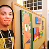 Gloucester: Jason Burroughs a student artist at Art Haven,stands next to his art work that he displayed at Cruiseport ,for Art Haven's Buoy silent auction.  Desi Smith/Gloucester Daily Times.