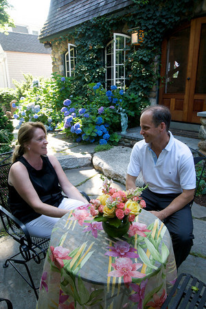 Peter and Julie Fariel sit on their back patio of their Norwood Ave home.<br /> Photo by Kate Glass.