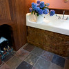 A dog house for Ressie, the family collie, is in the mud room.  Peter and Julie Fariel turned a simple summer cottage on Norwood Ave in Rockport into an elegant year-round home.<br /> Photo by Kate Glass.