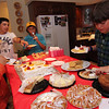 Allegra Boverman/Cape Ann Magazine. Explaining all the desserts, second from left, is Vincent Giacolone, his brother Joey at left. They had their friends, twins Curtis and Robbie Welcome, at right, over for St. Anthony's birthday.