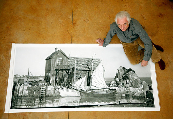 Allegra Boverman/Cape Ann Magazine. Photographer Les Bartlett of Rockport with his large scale image of Motif No. 1 at his Lanesville studio.