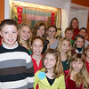 "Robert Whitmarsh/Courtesy photo ""Holiday Delights"" cast members ages 6 to 18  with ""Holiday Delights"" director Heidi Dallin, far left, and music director Helen Greene, right, rear, during the Gloucester Stage Company Gala. The event, which included entertainment and dinner, was ""A Festive Holiday Celebration to Benefit Gloucester Stage Company on Sat. Dec. 1, 2012 at the theater on 267 East Main Street in East Gloucester."