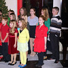 "Robert Whitmarsh/Courtesy photo Cast members from the Gloucester Stage Youth Acting Workshop's production of ""Holiday Delights"" perform songs from the show for party guests, during the Gloucester Stage Company's gala. The event, which included entertainment and dinner, was ""A Festive Holiday Celebration to Benefit Gloucester Stage Company on Sat. Dec. 1, 2012 at the theater on 267 East Main Street in East Gloucester."