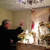 Photo courtesy of Rosemarie Abell/Cape Ann Magazine. Rev. Kiley does the blessing during the Mass at the Ciaramitaro home on St. Anthony's birthday.