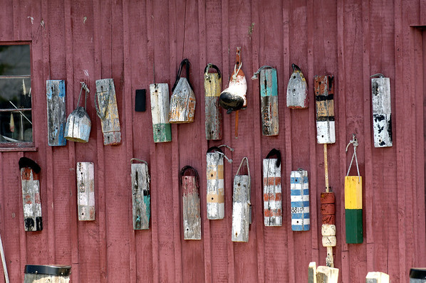 Jim Daly/Cape Ann Magazine. Details of the buoys hanging on Motif No. 1 in Rockport.