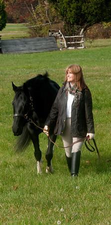 Jim Vaiknoras/Cape Ann Magazine: Meg Griffin walks her horse Soxy through field at Myopia in Hamilton.