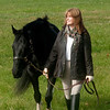 Jim Vaiknoras/Cape Ann Magazine: Meg Griffin walks her horse Soxy through field at Myopia in Hamilton.