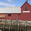 """Mike Dean/Cape Ann Magazine. A couple of signs were hung on Motif No. 1 to make it look like a fish shack in Sitka, Alaska, for the Disney film """"The Proposal,""""  starring Sandra Bullock and Ryan Reynolds. Much of the filming was done in Rcokport in April 2008."""