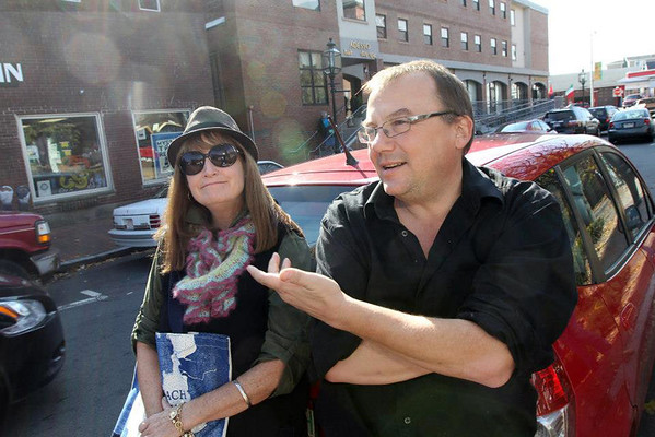Allegra Boverman/Cape Ann Magazine. Radio host Meg Griffin of Gloucester, left, outside Mystery Train Records in downtown Gloucester with Cape Ann Magazine photographer Jim Vaiknoras during their photo shoot in the fall.