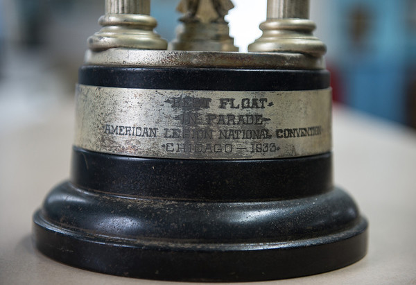 Desi Smith/Cape Ann Magazine. Detail of a first-place trophy that was given to the Motif No. 1 float for Best Float in Parade, at the American Legion National Convention in Chicago 1933.