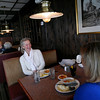 Allegra Boverman/Cape Ann Magazine. Realtors and friends Kathleen Claypool, right, of Rockport and Chris Viegaard of Gloucester eat lunch recently at Village Restaurant in Essex.