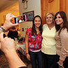 Allegra Boverman/Cape Ann Magazine. Rosemarie Ciaramitaro, left, takes a photo of her mother, Grace Ciaramitaro, center, with two of her granddaughters Talia Ciaramitaro, left, and Ali Abell.
