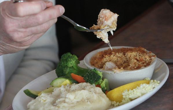 Allegra Boverman/Cape Ann Magazine. The seafood pie at Village Restaurant in Essex. Eaten by Chris Viegaard of Gloucester.