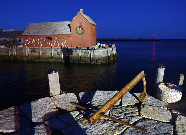 Kate Glass/Cape Ann Magazine.  Rockport's Motif No. 1 illuminated at night.