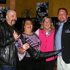 """Gail McCarthy/Cape Ann Magazine. """"Wicked Tuna"""" Capts. Dave Marciano of the Hard Merchandise, far left, and Kevin Leonowert of the Christina flank City Councilor Sefatia Romeo Theken, left, and Gloucester Mayor Carolyn Kirk at the premiere party in Boston for the show's second season."""