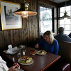 Allegra Boverman/Cape Ann Magazine. Realtors and friends Kathleen Claypool, second from left, of Rockport and Chris Viegaard of Gloucester, left, ate lunch recently at Village Restaurant in Essex. They had the seafood pie, the lunch special that day.