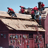 Mike Dean/Cape Ann Magazine. A 10-man crew from Precision Roofing Services of Gloucester reroofs Rockport's historic Motif No. 1 building in June 2006. Town officials said the next step in the Motif's revitalization project would be giving the building a new coat of paint.