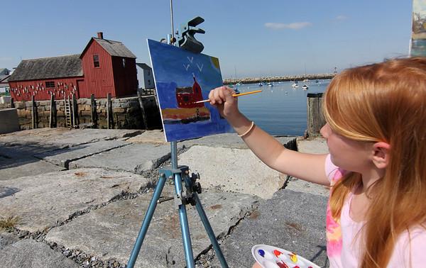 Allegra Boverman/Cape Ann Magazine. Sarah Vanderpool of Rockport at T Wharf painting Motif No. 1.
