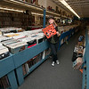 Jim Vaiknoras/Cape Ann Magazine: Meg Griffin looks over the vinyl records at Mystery Train Records on Main Street in Gloucester.