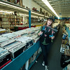 Jim Vaiknoras/Cape Ann Magazine: Meg Griffin looks over vinyl records at Mystery Train Records on Main Street in Gloucester.