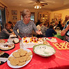 Allegra Boverman/Cape Ann Magazine. From left to right are Lia Militello and Catherina Cusumano try to decide what they want for dessert during the St. Anthony's feast.