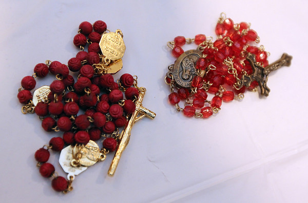 Allegra Boverman/Cape Ann Magazine. Rosaries. There are so many types of beads that people bring that have been passed down to them from other family members over the years. The rosary at left are made out of roses from the funeral of a deceased family member and still retain their scent.