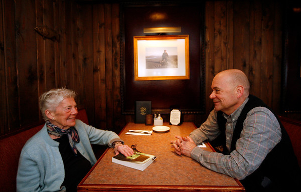 Allegra Boverman/Cape Ann Magazine. Kevin Ricci, right, co-owner of Village Restaurant in Essex, with his mother Kathleen Ricci, in a cozy booth in the restaurant's bar.