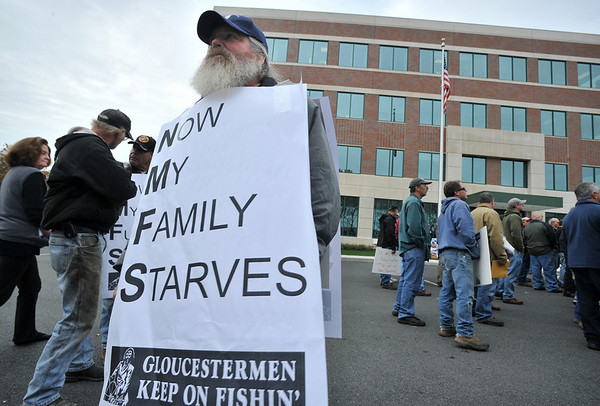 Josh Reynolds/Associated Press Paul Cohan, then captain of the Gloucester fishing boat Sasquatch, wears a sign referring to the National Marine Fisheries Service, as he joins hundreds of fishermen demonstrating against new fishing regulations outside National Oceanic and Atmospheric Administration building in Gloucester on  Oct. 29, 2009.