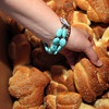 Allegra Boverman/Cape Ann Magazine. Ali Abell reaches in for some bread to fill bags for family and friends to take home after the evening feast is over at the Ciaramitaro home.
