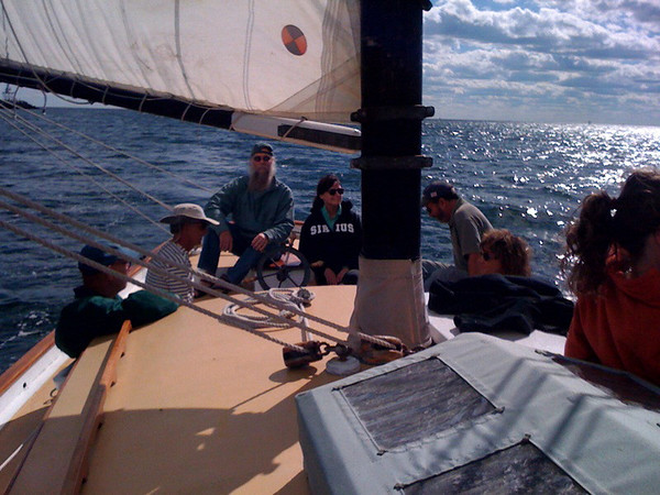 "Courtesy photo/Cape Ann Magazine Meg Griffin, (with Sirius sweatshirt) sails with her neighbors, Paul Cole and Judy Nast, during the annual Gloucester Schooner Races on Labor Day weekend. They sail on the Bald Eagle out of Gloucester. ""Sometimes we even place,"" Griffin said."