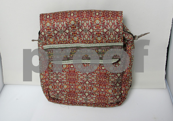 Nothing says winter like the russet hues in this Derin bag, with  rich woven fabrics and coordinating borders<br /> Backpack $54