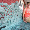 Gloucester: Shelly Bradbury sits on the bench she sculpted outside of the Cape Ann Maritime. Photo by Kate Glass