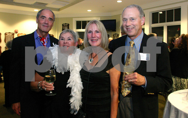 "Gloucester: Heinz Grohs, right, Dawn Grohs, Chris Barker and Jim Barker attend the annual ""Raising the Roof gala"" put on by Rockport Music and the Bass Rocks Golf Club.<br /> Photo Silvie Lockerova"