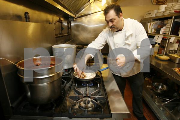 Chef Peter Cusenza prepares the veal bracciolettini at La Trattoria.  Staff photo by Kate Glass