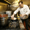 Chef Peter Cusenza prepares the veal bracciolettini at La Trattoria.  Staff photo by Kate Glass