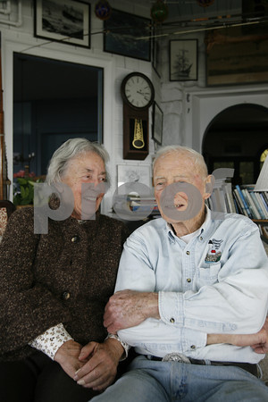 Gloucester author Joe Garland and his wife, Helen, at their home on Eastern Point. Photo by Kate Glass
