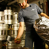 T.J. Peckham adds hops to the boil.<br /> Photo by Kate Glass