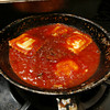 Raviolis cook in Sal LoGrasso's meat sauce at LoGrasso's in Rockport.  Staff photo by Kate Glass