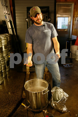 T.J. Peckham discusses the type of hops used in their beer.<br /> Photo by Kate Glass