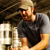 T.J. Peckham breaks apart the hops used in strawberry rhubarb beer.