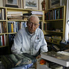 Gloucester author Joe Garland in his study. He summered in Gloucester as a boy and became a year-long resident when he bought his home on Eastern Point in 1959.<br /> Photo by Kate Glass.