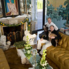 """Alexander Westerhoff relaxes in the living room of """"Serenity"""" the home he and Tom Lang, right, own in Manchester-by-the-Sea. <br /> The mantel is from the Doris Duke estate in Newport, R.I. mid 18th-Century English, which they painstakling restored.<br /> The marble Venetian  lions flanking the fireplace are early 17th-Century.  Murals painted by Julia Purinton, Medusa Studios.  Photo by Mary Muckenhoupt."""