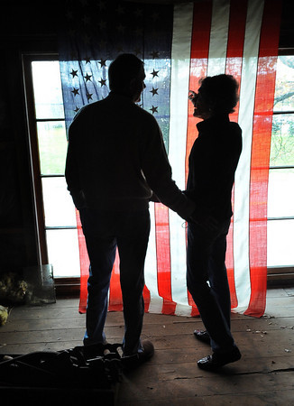 Essex: Bill Friend , owner of Friendship Antiques, talks with his wife Judy on the final day in the empty Barn on 55 John Wise Ave that he called his second home for 40 years. Desi Smith Photo. October 29,2010.