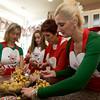 Jill Ciaramitaro, Amanda Mohan, Eleanor Curcuru, and Gina Ciaramitaro mix the Pinulata with nuts, chocolate and cinnamon.