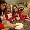 Felicia Mohan mixes eggs and durham wheat flour to make Pinulata as Eloise Ciaramitaro, Amanda Mohan, Madeline Ciaramitaro and Rose Ciaramitaro watch.