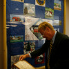 Granite Savings Bank President Norman Seppala looks at information on the Rockport quilt that was made to celebrate the country's bicentennial. The quilt is on display at their new location on Upper Main Street.