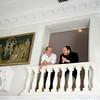 Alexander Westerhoff, left, and Tom Lang were married in 2004 and have been together for 23 years. The couple stand outside of their bedroom over looking the grand loggia. Photo by Mary Muckenhoupt.