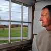 Essex: Owner of Friendship Antiques Bill Friend looks out the window for the last time at 55 John Wise Ave that he called his second home for 40 years. Desi Smith Photo. October 29,2010.