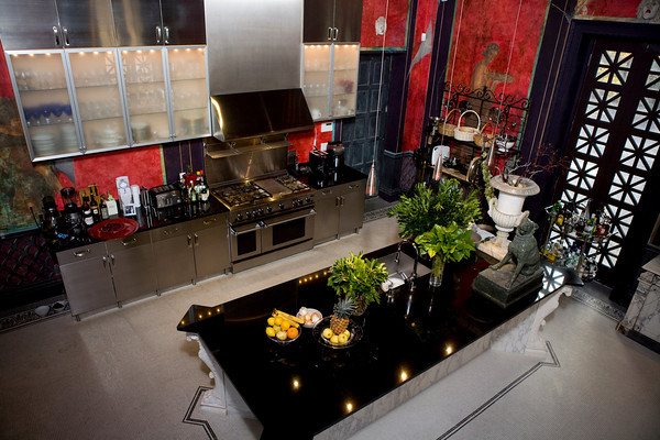 The kitchen design was inspired by the Villa of The Mysteries at Pompei. The walls are painted in deep red with intricate murals done by Murals by Medusa Studios in Ipswich.  The stainless steel compliments the design and everything is custom made.<br /> Photo by Mary Muckenhoupt.