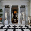 The loggia is an open room to the outside. <br /> This dramatic room has 28 foot ceilings with life-sized sculptures that the couple bought and stored for around 15 years before they built the home. On the left: Two works by Canova: Ajax, and  Venus.<br /> On the right is a sculpture from 1650 that was in the Tuileries Garden  in Paris. <br /> A 17th-Century German corbels stands at her feet.<br /> Photo by Amy Sweeney